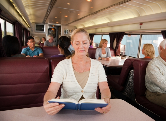 woman reading at dining car table