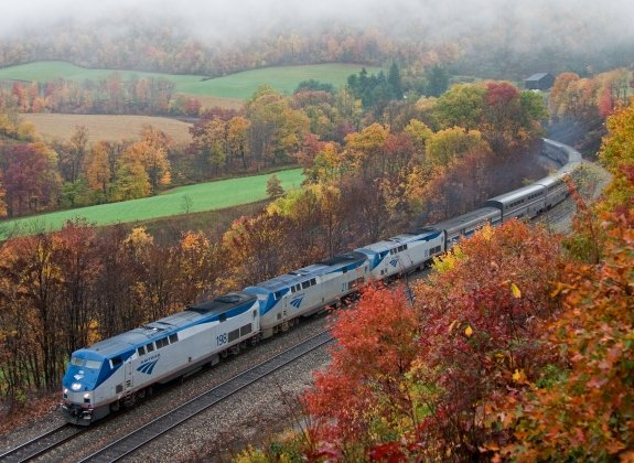 Amtrak's Capital Limited train route through field with autumn foliage