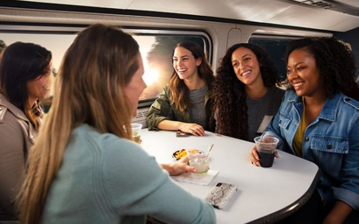 women talking in the cafe car onboard Amtrak
