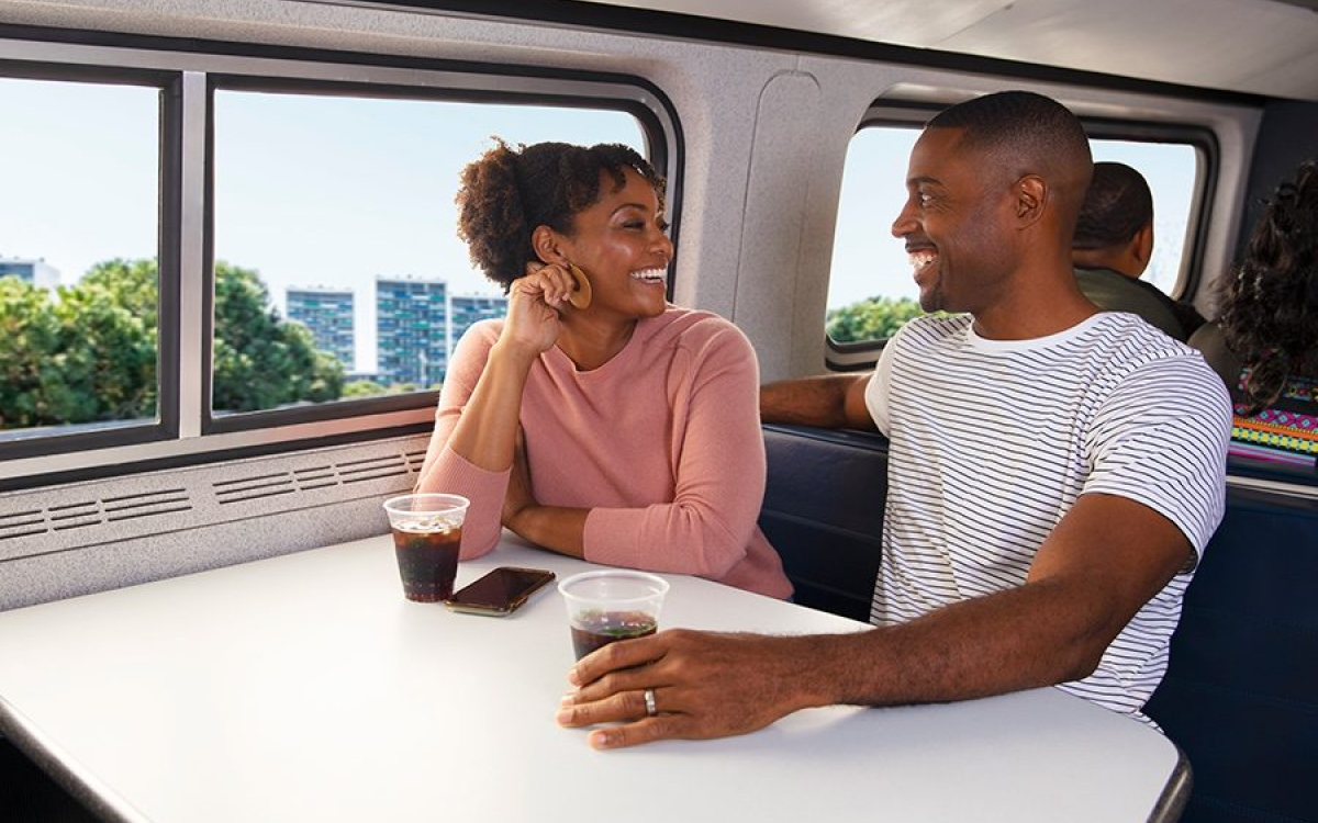 happy couple onboard amtrak
