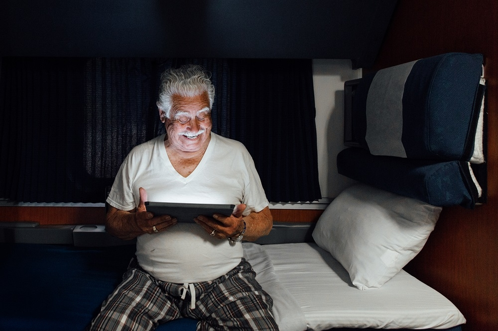 superliner accessible bedroom tablet at night